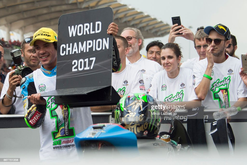 Franco Morbidelli of Italy and EG 00 Marc VDS celebrates under the podium the third place of the Moto2 race and the victory of the Moto2 World Championship at the end of the Moto2 race during the MotoGP Of Malaysia - Race at Sepang Circuit on October 29, 2017 in Kuala Lumpur, Malaysia.