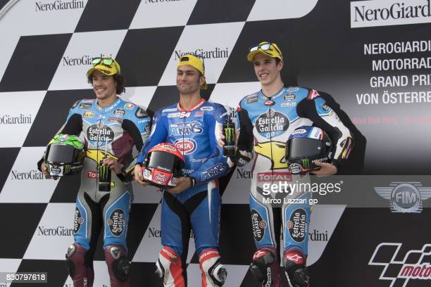Franco Morbidelli of Italy and EG 00 Marc VDS Mattia Pasini of Italy and Italtrans Racing Team and Alex Marquez of Spain and EG 00 Marc VDS celebrate...