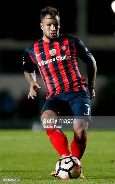 Franco Mussis of San Lorenzo drives the ball during a second leg match between San Lorenzo and Emelec as part of round of 16 of Copa CONMEBOL...