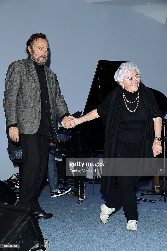 <a gi-track='captionPersonalityLinkClicked' href=/galleries/search?phrase=Franco+Nero&family=editorial&specificpeople=803339 ng-click='$event.stopPropagation()'>Franco Nero</a> and Lina Wertmuller attend Day 4 of the 2012 Capri Hollywood Film Festival on December 29, 2012 in Capri, Italy.