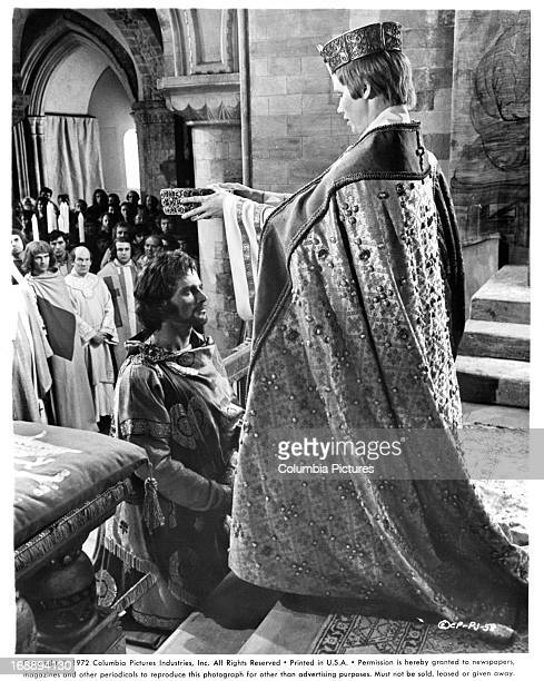 Franco Nero kneels in front of Liv Ullmann in a scene from the film 'Pope Joan' 1972