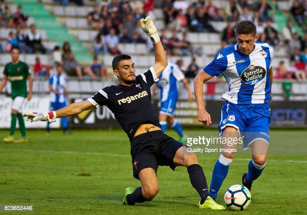 Franco Paron of Racing de Ferrol competes for the ball with Federico Valverde of Deportivo de la Coruna during the preseason friendly match between...
