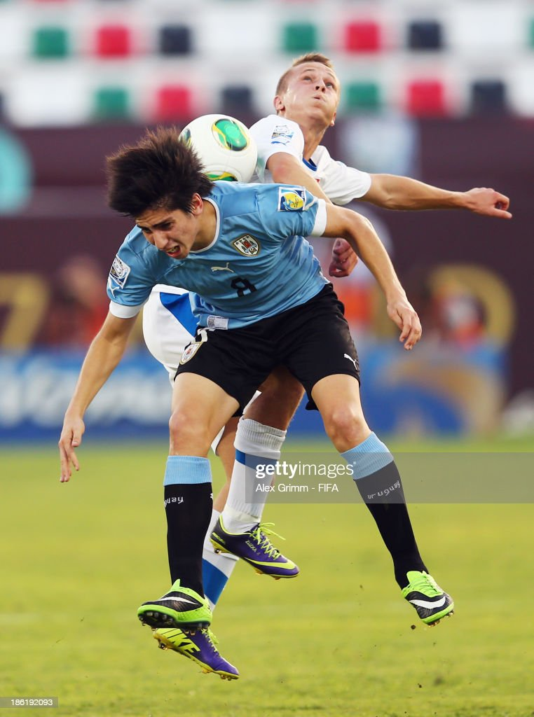 Franco Pizzichillo (front) of Uruguay is challenged by Martin Slaninka of Slovakia during the FIFA U-17 World Cup UAE 2013 Round of 16 match between Uruguay and Slovakia at Ras Al Khaimah Stadium on October 29, 2013 in Ras al Khaimah, United Arab Emirates.