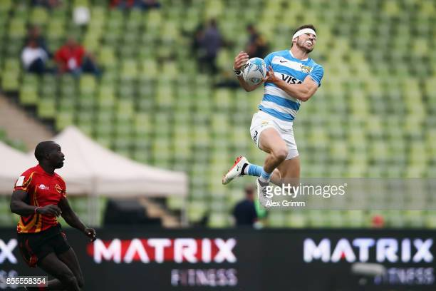 Franco Sabato of Argentina catches the ball ahead of James Odongo of Uganda during the match between Argentina and Uganda on Day 1 of the Rugby...