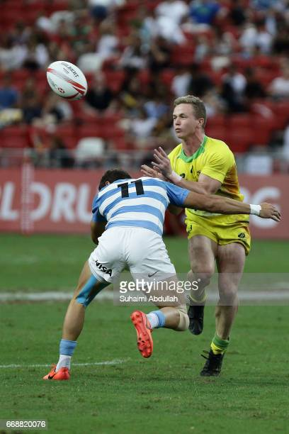 Franco Sabato of Argentina tackles Henry Hutchison of Australia during the 2017 Singapore Sevens match between Australia and Argentina at National...