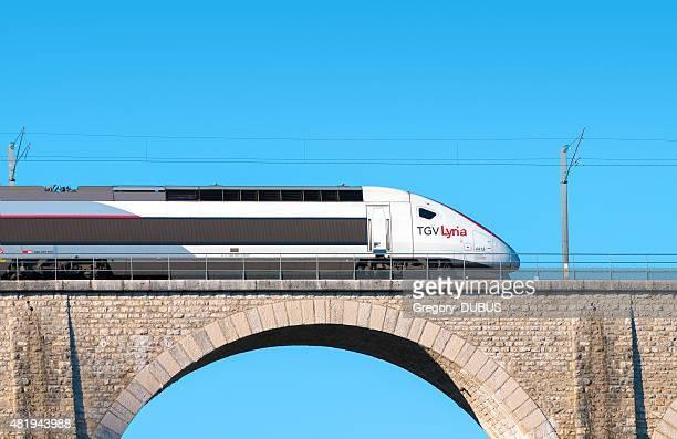 Franco Swiss TGV Lyria high speed train on stone bridge