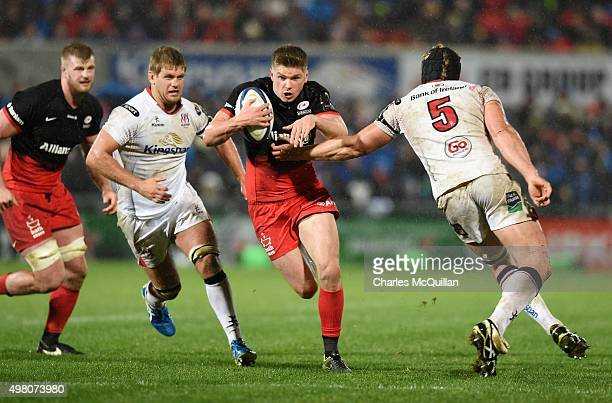 Franco Van Der Merwe and Chris Henry of Ulster attempt to tackle Owen Farrell of Saracens during the European Champions Cup Pool 1 rugby game at...