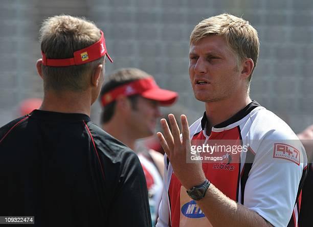 Franco van der Merwe and Johan Ackermann talk during the Lions training session at Johnannesburg Stadium on February 21 2011 in Johanessburg South...