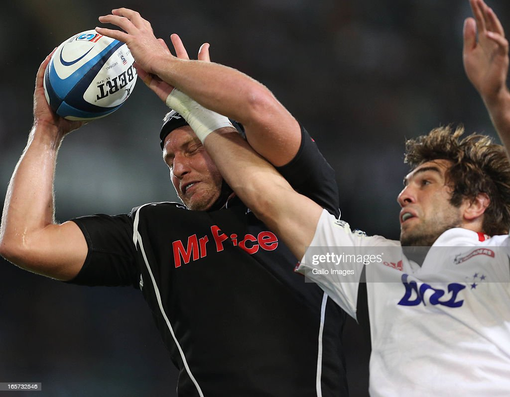 Franco van der Merwe of Sharks gets the ball away from <a gi-track='captionPersonalityLinkClicked' href=/galleries/search?phrase=Sam+Whitelock&family=editorial&specificpeople=6070892 ng-click='$event.stopPropagation()'>Sam Whitelock</a> of Crusaders during the Super Rugby match between The Sharks and Crusaders from Kings Park on April 05, 2013 in Durban, South Africa.