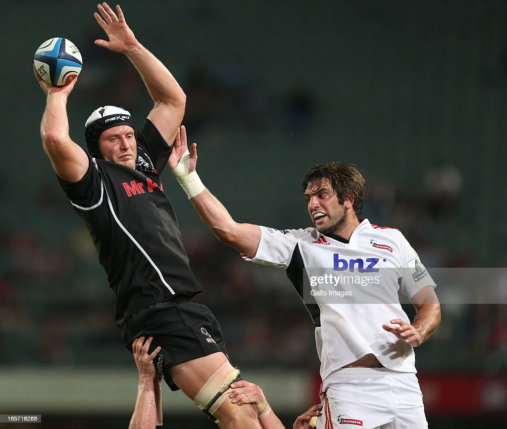 Franco van der Merwe of Sharks (L) out-jumps Sam Whitelock of Crusaders during the Super Rugby round eight match between the Sharks and Crusaders from Kings Park on April 05, 2013 in Durban, South Africa.