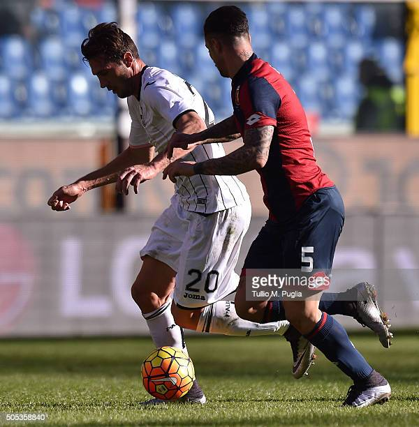 Franco Vazquez of Palermo and Armando Izzo of Genoa compete for the ball during the Serie A match between Genoa CFC and US Citta di Palermo at Stadio...