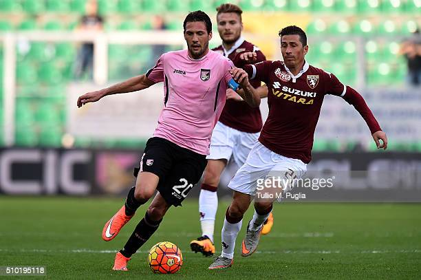 Franco Vazquez of Palermo and Giuseppe Vives of Torino compete for the ball during the Serie A match between US Citta di Palermo and Torino FC at...