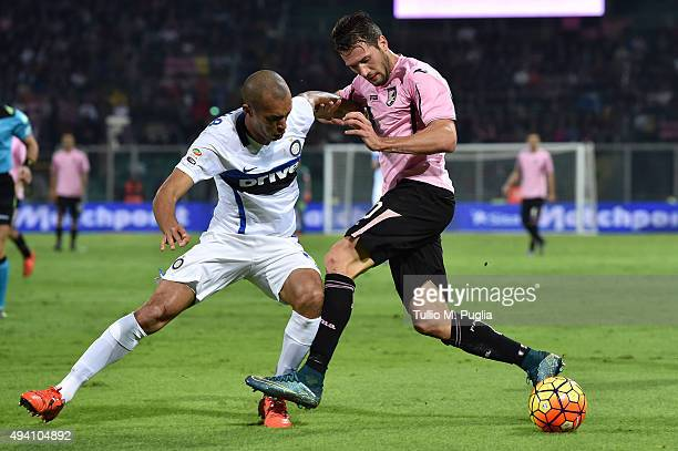 Franco Vazquez of Palermo and Joao Miranda of Palermo compete for the ball during the Serie a match between US Citta di Palermo and FC Internazionale...