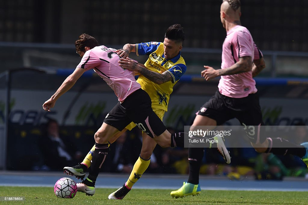 Franco Vazquez of Palermo and Lucas Castro of Chievo Verona fight for the ball during the Serie A match between AC Chievo Verona and US Citta di...