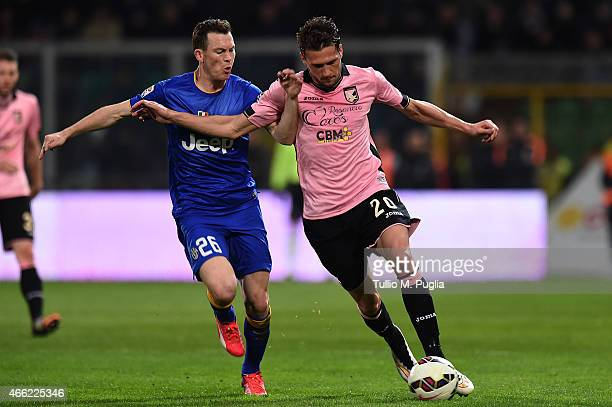 Franco Vazquez of Palermo and Stephan Lichtsteiner of Juventus compete for the ball during the Serie A match between US Citta di Palermo and Juventus...