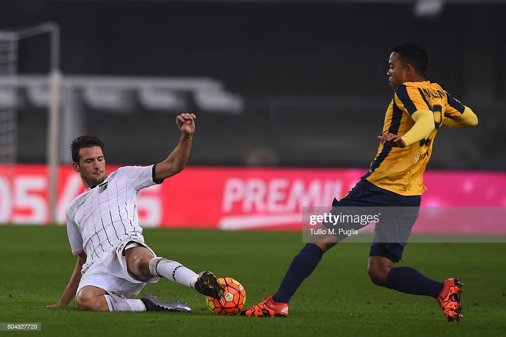 Franco Vazquez of Palermo and Urby Emanuelson of Hellas verona compete for the ball during the Serie A match between Hellas Verona FC and US Citta di...