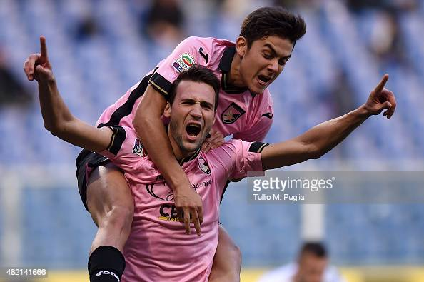 Franco Vazquez of Palermo celebrates with Paulo Dybala after scoring the equalizing goal during the Serie A match between UC Sampdoria and US Citta...
