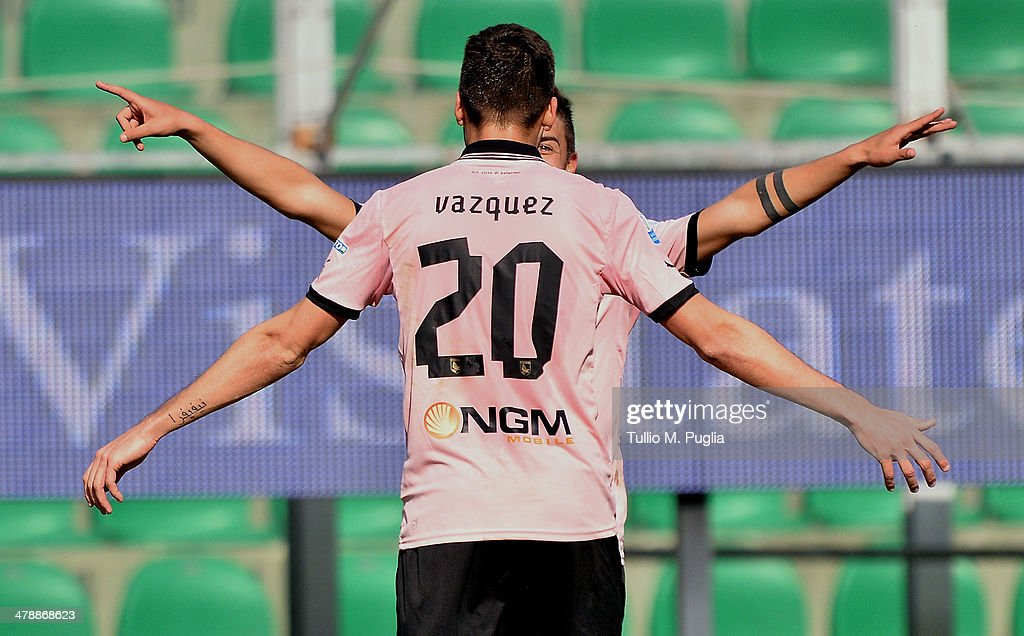 Franco Vazquez of Palermo celebrates with team mate Paulo Dybala after scoring the opening goal during the Serie A match between US Citta di Palermo...