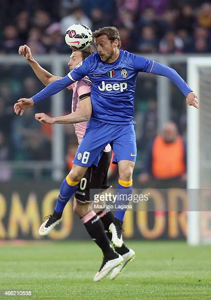 Franco Vazquez of Palermo competes for the ball in air with Claudio Marchisio of Juventus during the Serie A match between US Citta di Palermo and...