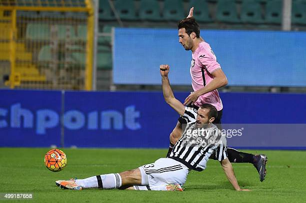 Franco Vazquez of Palermo in action as Giorgio Chiellini of Juventus tackles during the Serie A match between US Citta di Palermo and Juventus FC at...