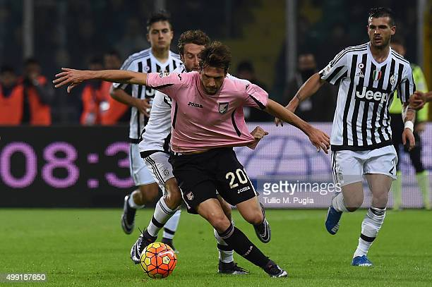Franco Vazquez of Palermo is callanged by Claudio Marchisio of Juventus during the Serie A match between US Citta di Palermo and Juventus FC at...