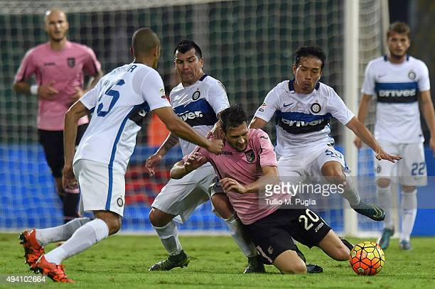 Franco Vazquez of Palermo is chaleenged by Joao Miranda Gary Medel and Yuto Nagatomo of Inter during the Serie A match between US Citta di Palermo...