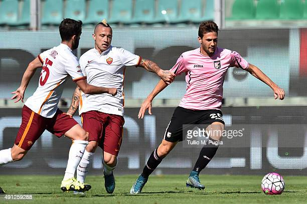 Franco Vazquez of Palermo is challenged by Radja Nainggolan and Miralem Pjanic of Roma during the Serie A match between US Citta di Palermo and AS...