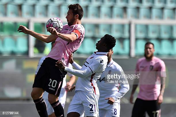 Franco Vazquez of Palermo jumps for the ball Amadou Diawara of Bologna tackles during the Serie A match between US Citta di Palermo and Bologna FC at...