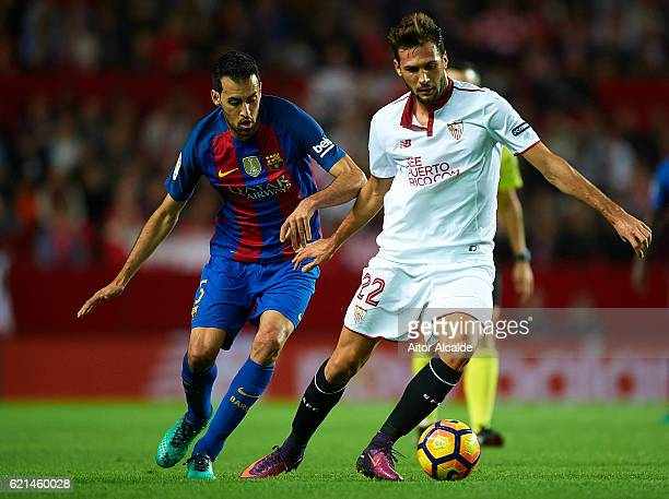 Franco Vazquez of Sevilla FC being followed by Sergio Busquets of FC Barcelona during the match between Sevilla FC vs FC Barcelona as part of La Liga...
