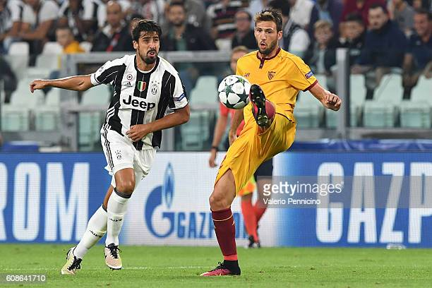 Franco Vazquez of Sevilla FC controls the ball against Sami Khedira of Juventus FC during the UEFA Champions League Group H match between Juventus FC...
