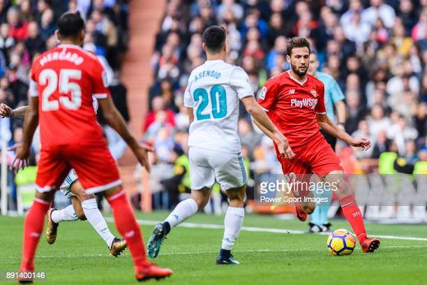 Franco Vazquez of Sevilla FC in action against Marco Asensio of Real Madrid during the La Liga 201718 match between Real Madrid and Sevilla FC at...