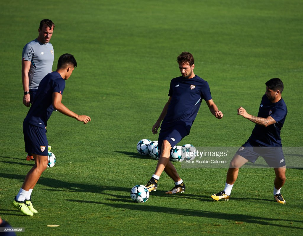 Franco Vazquez of Sevilla FC (C) in action during the training session prior to their UEFA Champions League match against Istanbul Basaksehir at the Sevilla FC training ground on August 21, 2017 in Seville, Spain.