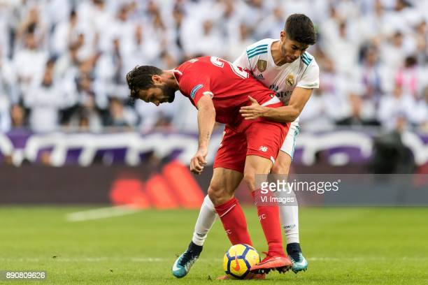 Franco Vazquez of Sevilla FC Marco Asensio of Real Madrid during the La Liga Santander match between Real Madrid CF and Sevilla FC on December 09...