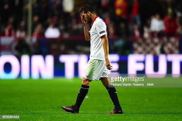 Franco Vazquez of Sevilla walks off after being shown a red card during the UEFA Champions League match between Sevilla FC and Juventus at Estadio...