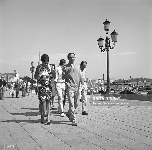 Francoarmenian singer Charles Aznavour portrayed while walking on Riva degli Schivoni and eating an ice cream with his daughter Patricia called Seda...