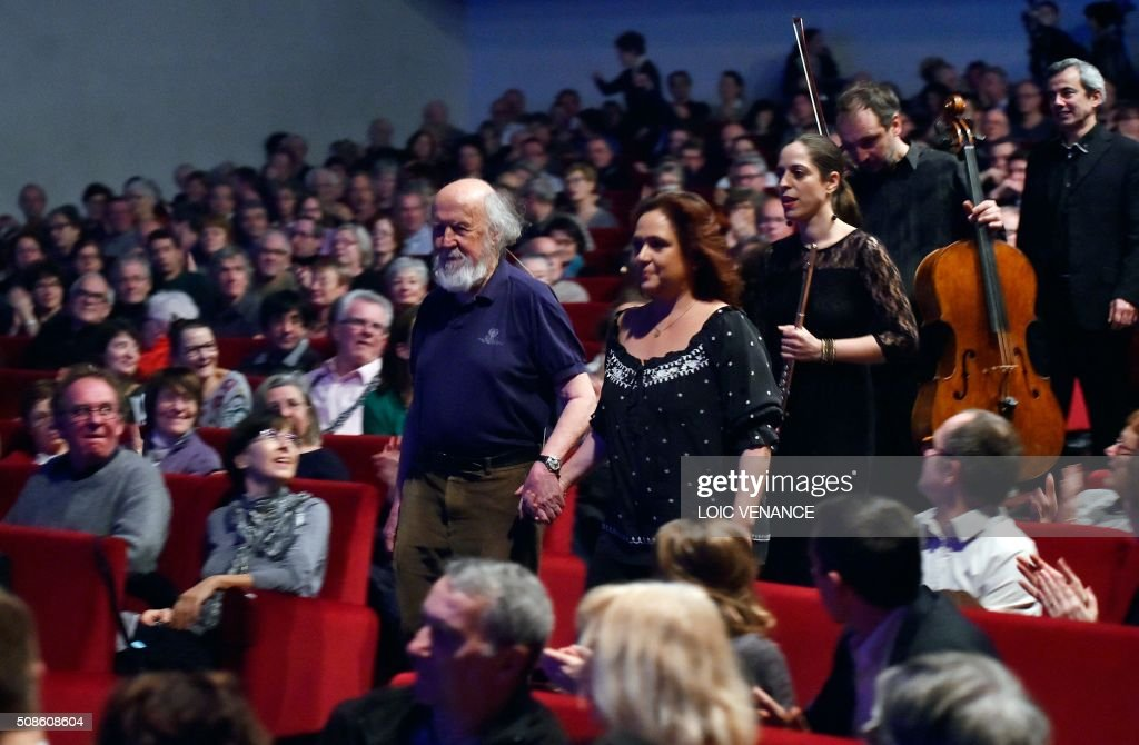 Franco-Canadian Astrophysicist Hubert Reeves and Artistic Director and violinist Karine Lethiec arrive to perform 'Cosmophonies' with Ensemble Calliopee during the 'Folle Journee de Nantes' classical music festival in Nantes, western France, on February 5, 2016. / AFP / LOIC VENANCE
