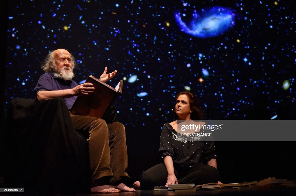 Franco-Canadian Astrophysicist Hubert Reeves and Artistic Director and violinist Karine Lethiec perform 'Cosmophonies' with Ensemble Calliopee during the 'Folle Journee de Nantes' classical music festival in Nantes, western France, on February 5, 2016. / AFP / LOIC VENANCE