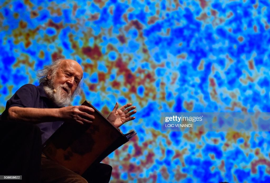Franco-Canadian Astrophysicist Hubert Reeves performs 'Cosmophonies' with Ensemble Calliopee during the 'Folle Journee de Nantes' classical music festival in Nantes, western France, on February 5, 2016. / AFP / LOIC VENANCE