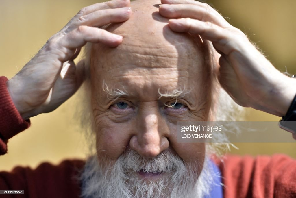 Franco-Canadian Astrophysicist Hubert Reeves poses prior to performing 'Cosmophonies' with Ensemble Calliopee during the 'Folle Journee de Nantes' classical music festival in Nantes, western France, on February 5, 2016. / AFP / LOIC