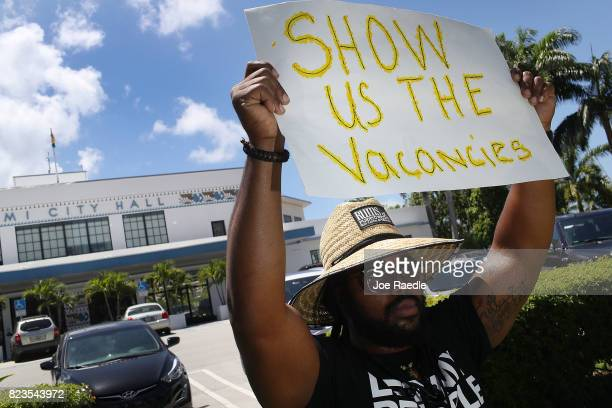 Francois Alexandre joins protesters in front of Miami City Hall as they ask for affordable housing to be set aside in the city and county on July 27...