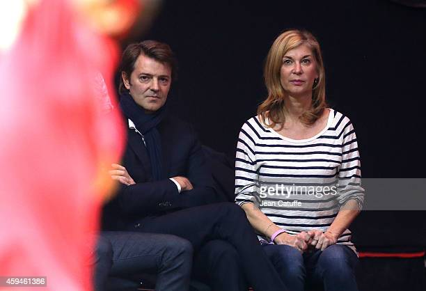 Francois Baroin and Michele Laroque attend day three of the Davis Cup tennis final between France and Switzerland at the Grand Stade Pierre Mauroy on...