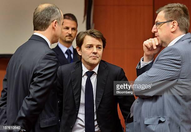 Francois Baroin France's finance minister center speaks with Steven Vanackere Belgium's finance minister right during a European Union finance...