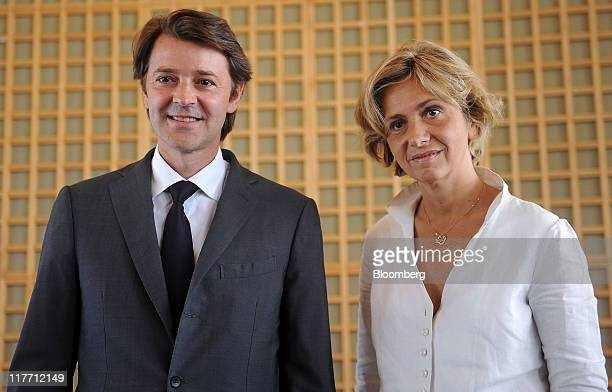 Francois Baroin France's finance minister left and Valerie Pecresse France's budget minister attend a news conference in Paris France on Thursday...