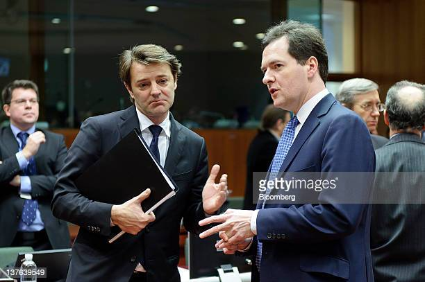 Francois Baroin France's finance minister left reacts as he speaks with George Osborne UK chancellor of the exchequer ahead of a meeting of European...