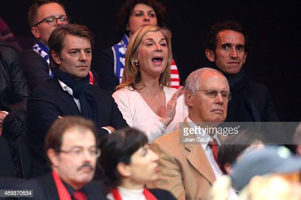 Francois Baroin his girlfriend Michele Laroque and Alexandre Bompard attend day one of the Davis Cup tennis final between France and Switzerland at...