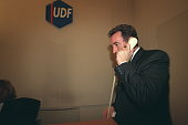 Francois Bayrou telephones from the party's headquarters