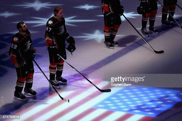 Francois Beauchemin and Hampus Lindholm of the Anaheim Ducks stand on the ice during the singing of the national anthem before playing the Chicago...