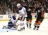 Francois Beauchemin and Nate Thompson of the Anaheim Ducks celebrate after Beauchemin's first period goal gets by goalie Ben Scrivens of the Edmonton...