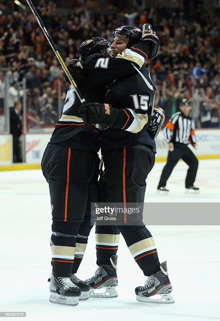 Francois Beauchemin #23 and Ryan Getzlaf #15 of the Anaheim Ducks celebrate a goal by teammate Corey Perry (not pictured) against the St. Louis Blues in the third period at Honda Center on March 10, 2013 in Anaheim, California. The Ducks defeated the Blues 4-2.
