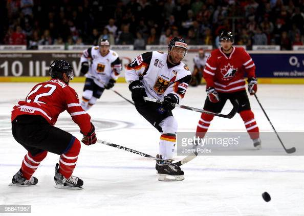 Francois Beauchemin of Canada challenges Sven Felski of Germany during the pre IIHF World Championship match between Germany and Canada at the O2...